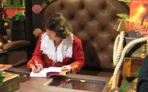 Geraldine McCaughrean  at Harrods, wearing the coat I made for the launch of Peter Pan in Scarlet.